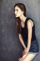 fashion young woman on grunge wall background