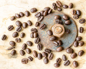 Coffee bean and nuts on grunge wooden background
