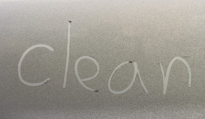"""Clean"" written on a dirty car"