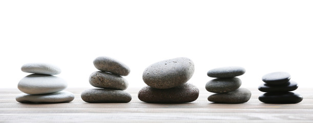 Spa stones on table on light background