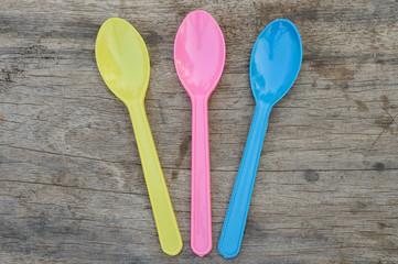 plastic spoon on wood background