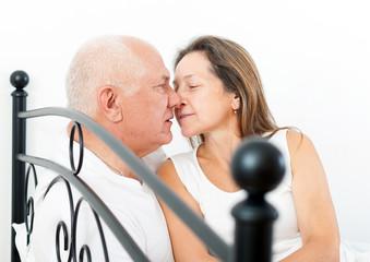 Beautiful elderly couple embracing
