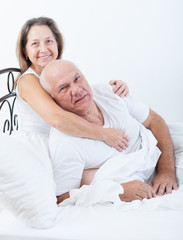 Senior  man and   woman resting on   bed
