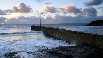 Sunset at the pier on Porthleven harbour on the Cornwall coast