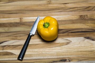 Yellow Pepper on Cutting Board