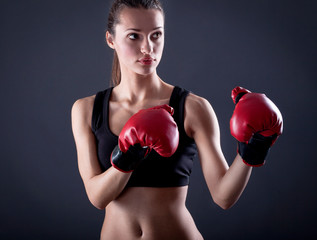 female kick  boxer with red gloves
