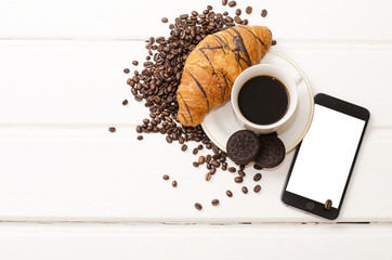 Business Breakfast, black coffee and chocolate croissant