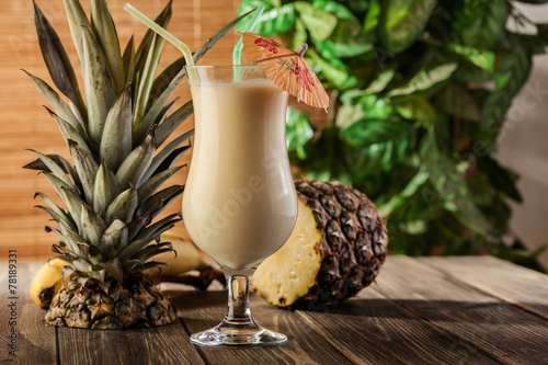 Fotobehang Cocktail Pina Colada over wooden background