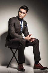 elegant business man sitting and looking to his side