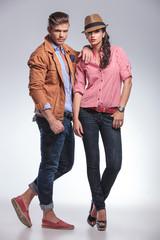 fashion couple posing on grey studio background