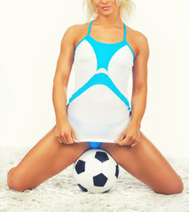 Image of lying woman with ball in studio