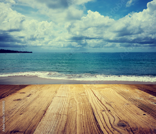 Deurstickers Water wooden table background on the tropical beach