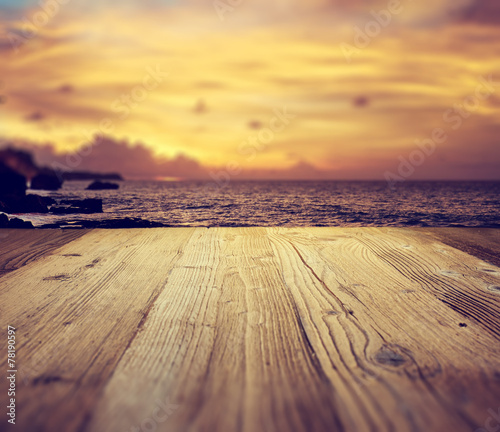 Fotobehang Golven wooden table background on the tropical beach
