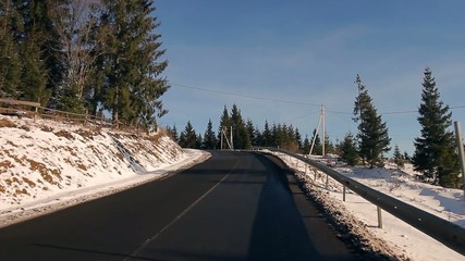 Road in the mountains. Sunny winter day.