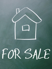 for sale sign on blackboard