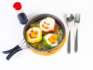 omelet on colorful peppers on pan