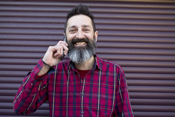 bearded man with mobile phone