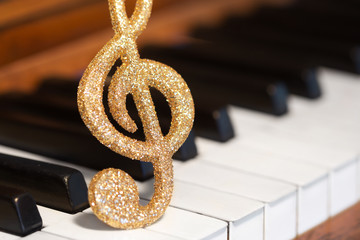 Golden Music note on piano keys