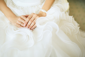 bride's Hands on white dress