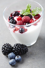 Jar of fresh yoghurt with summer fruits,  studio