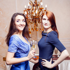 Portrait of cheerful girl with champagne