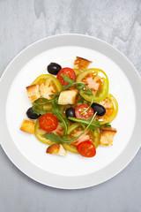 fresh vegetable salad with mozzarella on grey