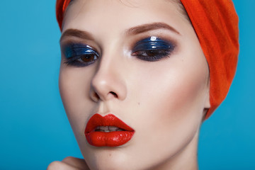 Beautiful sexy woman color makeup red lips blue eyes cosmetics