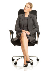 Businesswoman sitting on armchair
