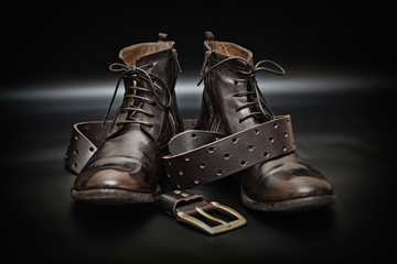Fashionable leather men's shoes and leather belt with a buckle