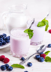 Milkshake with blueberries, raspberries and mint