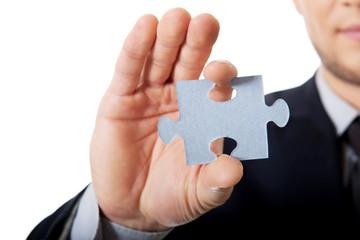 Businessman holding a puzzle.