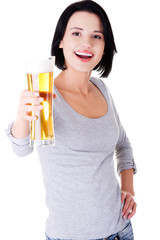 Young happy woman holding a glass of beer