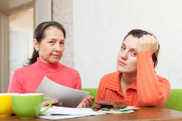 mother scolds adult daughter for bills or credits