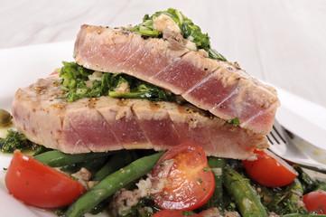 Seared tuna steak with bean and tomato salad
