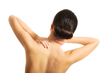 Rear view of topless woman with neck pain