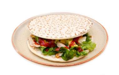Flatbread with chicken and salad on white background