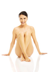 Front view nude woman sitting, propping up floor