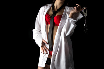 Photo woman in men's shirt with pair of handcuffs