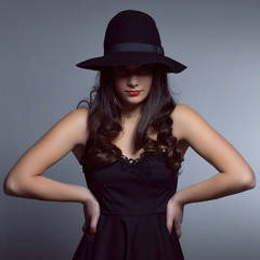 Portrait of elegant woman in fashion pose