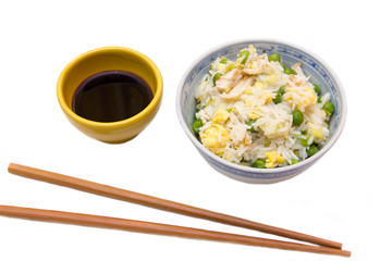 Rice with chicken and eggs on white background
