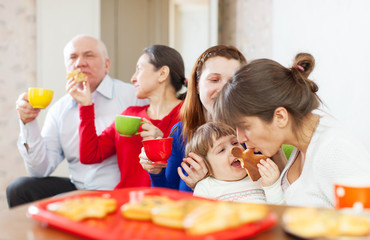 multigeneration family communicate over tea