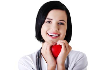 Portrait of female doctor holding heart model