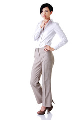 Full length businesswoman with silence sign