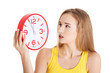Woman in yellow top holding a clock.