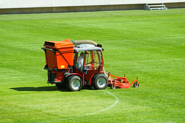 Mowing the grass on the football field