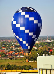 Hot air balloon in the air over the city