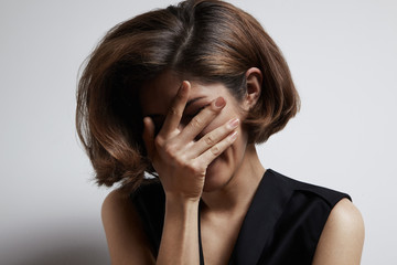 woman cover her face with a hand