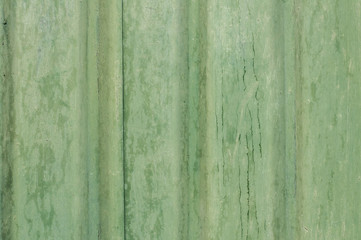 Painted grunge green tin wall surface as background