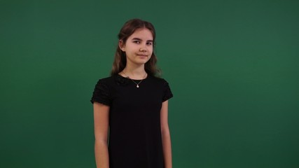 young beautiful girl on a green background