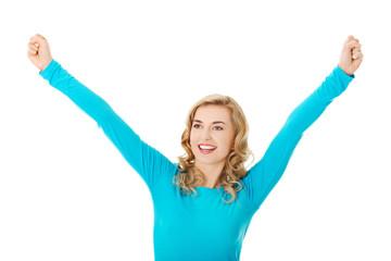 Portrait of a woman making winner gesture